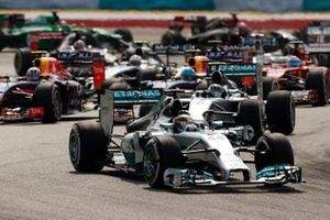 Lewis Hamilton, Mercedes W05, leads Nico Rosberg, Mercedes W05, Daniel Ricciardo, Red Bull Racing RB10 Renault, Sebastian Vettel, Red Bull Racing RB10 Renault, Fernando Alonso, Ferrari F14T, and the rest of the field