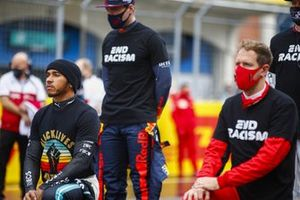 LanMax Verstappen, Red Bull Racing, Sebastian Vettel, Ferrari, and the other drivers stand and kneel in support of the End Racism camapaign