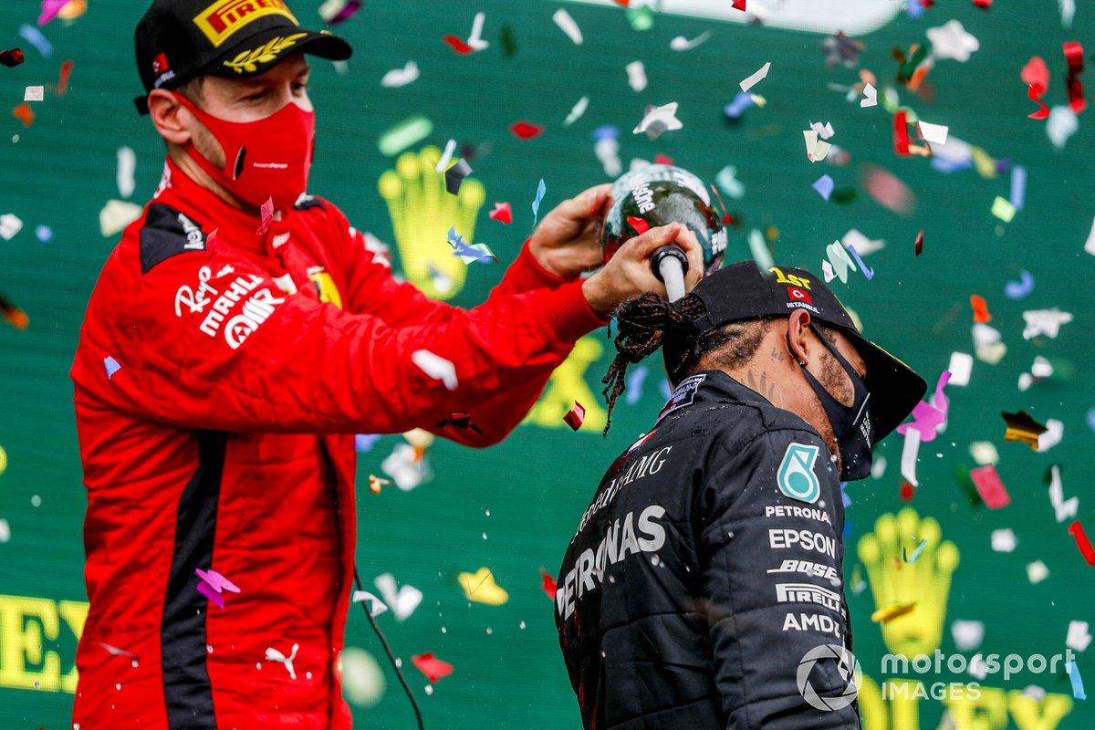 Sebastian Vettel, Ferrari, 3rd position, pours Champagne down the back of Lewis Hamilton, Mercedes-AMG F1, 1st position, on the podium