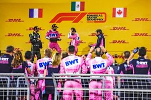 Esteban Ocon, Renault F1, 2nd position, Sergio Perez, Racing Point, 1st position, Lance Stroll, Racing Point, 3rd position, and Andy Stevenson, Sporting Director, Racing Point, celebrate with rose water on th podium