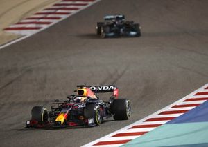 Max Verstappen, Red Bull Racing RB16B and Lewis Hamilton, Mercedes W12