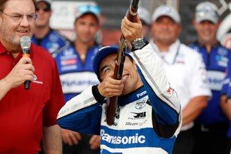 Takuma Sato, Rahal Letterman Lanigan Racing Honda celebrates winning the pole and a .50 caliber Henry Repeating Rifle