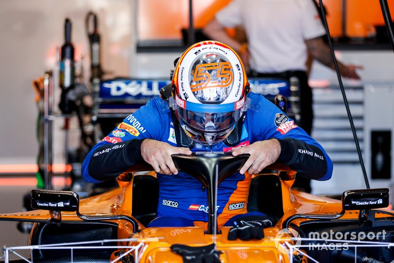 Carlos Sainz Jr, McLaren, climbs into his seat