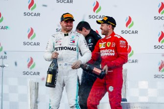 Valtteri Bottas, Mercedes AMG F1, 1st position, and Sebastian Vettel, Ferrari, 3rd position, celebrate on the podium