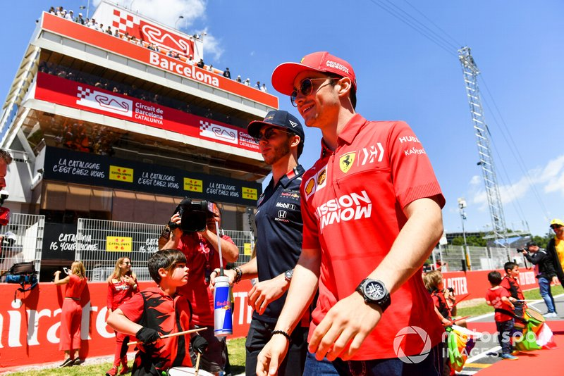 Pierre Gasly, Red Bull Racing, and Charles Leclerc, Ferrari, at the drivers parade