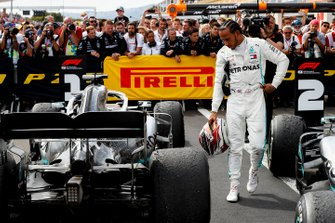 Lewis Hamilton, Mercedes AMG F1, 1st position, inspects his car in Parc Ferme