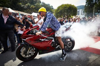 Lewis Hamilton, Mercedes AMG F1, arrives for a signing session in style on a motorbike ,with plenty of tyre smoke