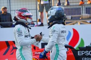 Lewis Hamilton, Mercedes AMG F1, and pole man Valtteri Bottas, Mercedes AMG F1, congratulate each other after Qualifying
