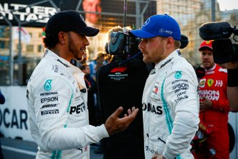 Front row starters Lewis Hamilton, Mercedes AMG F1, and pole man Valtteri Bottas, Mercedes AMG F1, talk after Qualifying