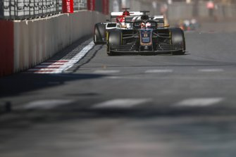 Romain Grosjean, Haas F1 Team VF-19, leads Kimi Raikkonen, Alfa Romeo Racing C38