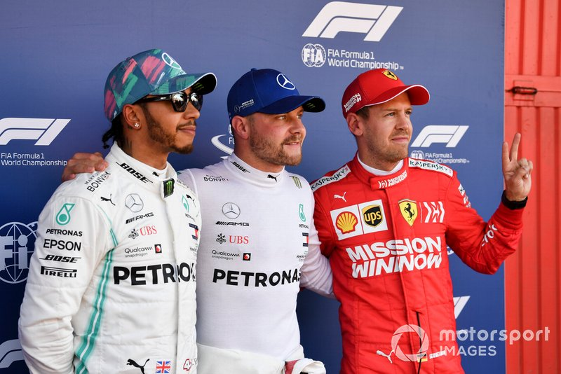 Top three Qualifiers, Lewis Hamilton, Mercedes AMG F1, pole man Valtteri Bottas, Mercedes AMG F1, and Sebastian Vettel, Ferrari