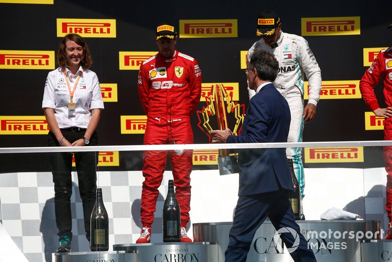 Sebastian Vettel, Ferrari, 2nd position, is presented with his trophy
