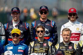 Daniil Kvyat, Toro Rosso, Alexander Albon, Toro Rosso and Antonio Giovinazzi, Alfa Romeo Racing stand behind Lando Norris, McLaren, Romain Grosjean, Haas F1 and Kevin Magnussen, Haas F1