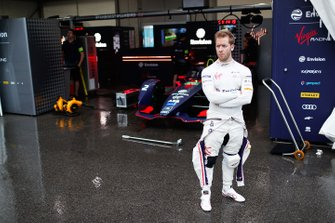 Sam Bird, Envision Virgin Racing stands in front of his Audi e-tron FE05 in the pit lane