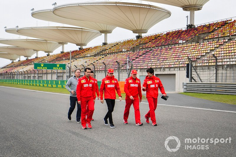 Charles Leclerc, Ferrari walks the track with his team