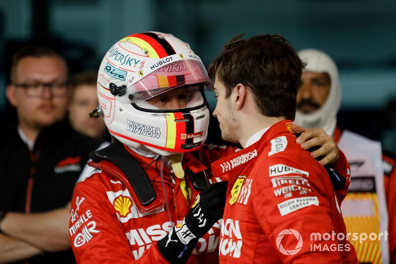 Sebastian Vettel, Ferrari, talks to his team mate Charles Leclerc, Ferrari, 3rd position, after the race