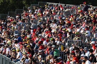 Fans watch from a packed grandstand