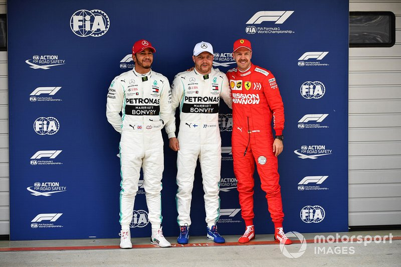 Top three Qualifiers Lewis Hamilton, Mercedes AMG F1, pole man Valtteri Bottas, Mercedes AMG F1, and Sebastian Vettel, Ferrari