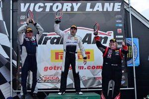 TA3 podium finishers Randy Kinsland, Mark Boden, and Cindi Lux