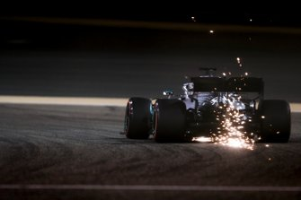 Sparks fly from the rear of Lewis Hamilton, Mercedes AMG F1 W10