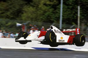 Mika Hakkinen, launches his Mclaren MP4/8 into the air at the Malthouse Corner