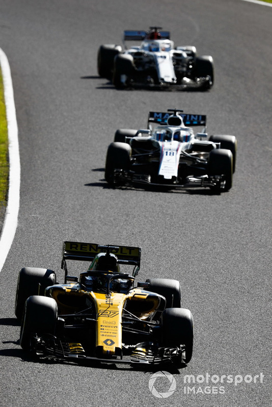 Nico Hulkenberg, Renault Sport F1 Team R.S. 18, leads Lance Stroll, Williams FW41, and Marcus Ericsson, Sauber C37