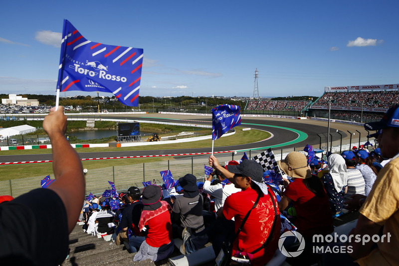 Fans with Toro Rosso flags await the start