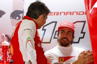 Fernando Alonso, Ferrari, and Marco Mattiacci, Team Principal, Ferrari,in the garage