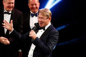 Mika Hakkinen receives a Gregor Grant Award on stage