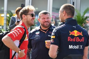 Sebastian Vettel, Ferrari talks with Red Bull Racing mechanics