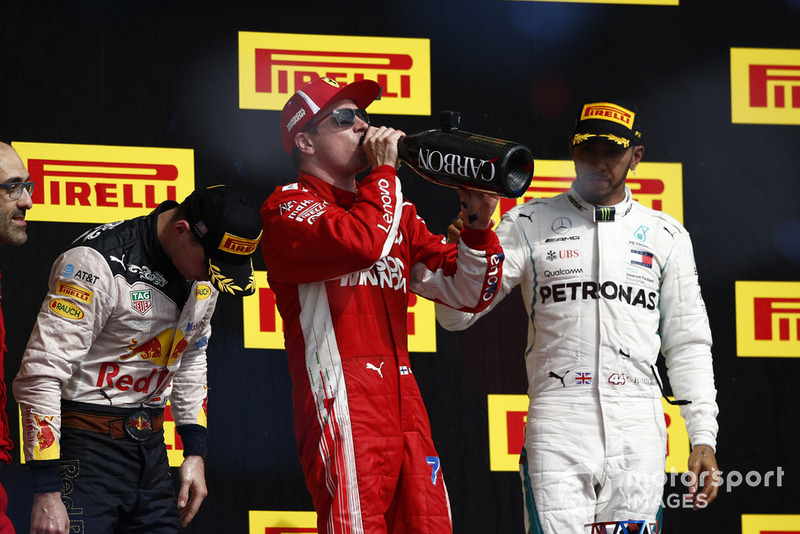 Kimi Raikkonen, Ferrari, 1st position, celebrates with Champagne on the podium