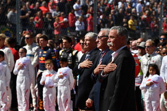 Chase Carey, Chief Executive Officer and Executive Chairman of the Formula One Group with Greg Maffei, President and CEO of Liberty Media and John Malone, Liberty Media Chairman observe the National Anthem on the grid