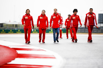 Sebastian Vettel, Ferrari, walks the track with his team.
