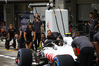 The Haas team practice pit stops