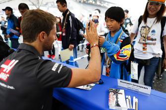 Romain Grosjean, Haas F1 Team, signs an autograph for a fan