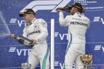 Valtteri Bottas, Mercedes AMG F1 and Lewis Hamilton, Mercedes AMG F1 celebrate with the champagne on the podium