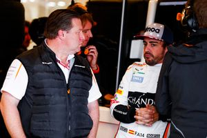 Zak Brown, Executive Director, McLaren Racing, talks with Fernando Alonso, McLaren, in the garage