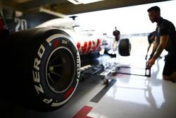 Haas mechanics work on a Haas F1 Team VF-18
