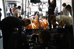 Engineers work on the car of Fernando Alonso, McLaren MCL33, in the garage