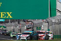 Michael Caruso, Nissan Motorsport Nissan, leads Garth Tander, Garry Rogers Motorsport Holden, and Wi