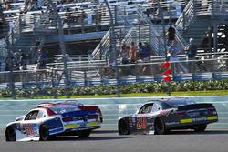 Ty Majeski, Roush Fenway Racing Ford and Christopher Bell, Joe Gibbs Racing Toyota