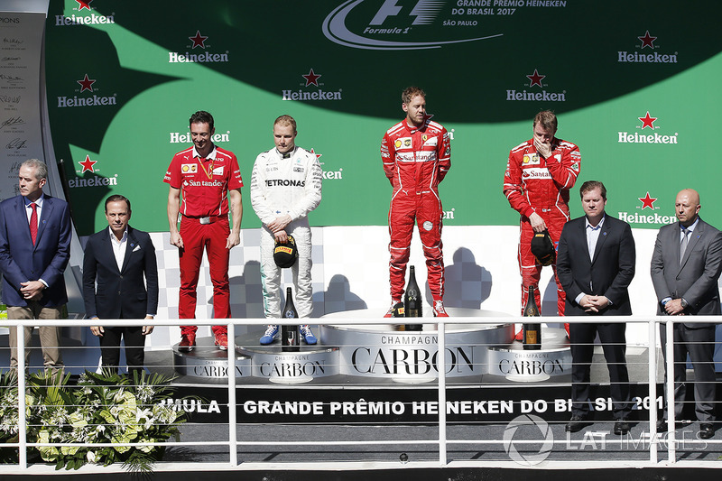 Podium: winner Sebastian Vettel, Ferrari, second place Valtteri Bottas, Mercedes AMG F1, third place Kimi Raikkonen, Ferrari