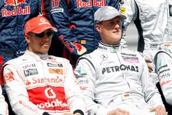 Lewis Hamilton, McLaren MP4-25, with Michael Schumacher, Mercedes GP W01