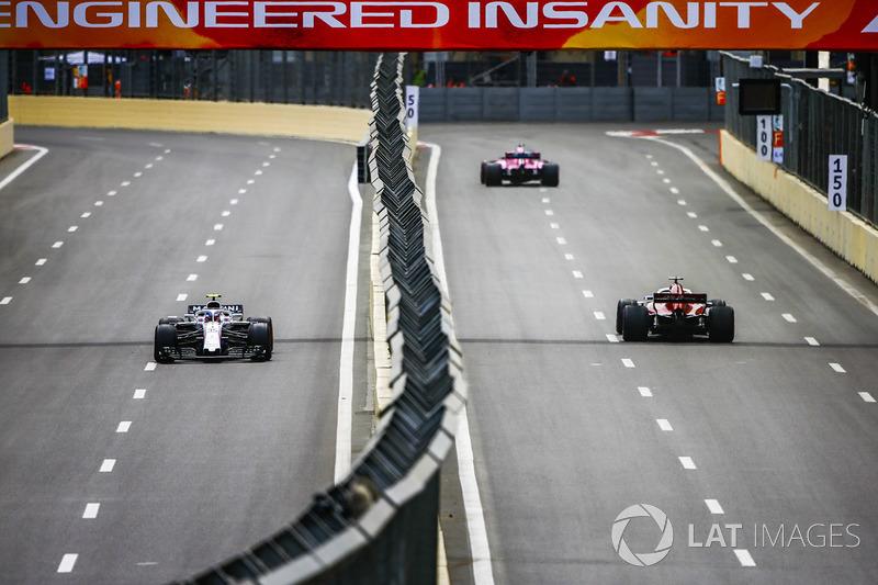 Marcus Ericsson, Sauber C37 Ferrari, leads Carlos Sainz Jr., Renault Sport F1 Team R.S. 18
