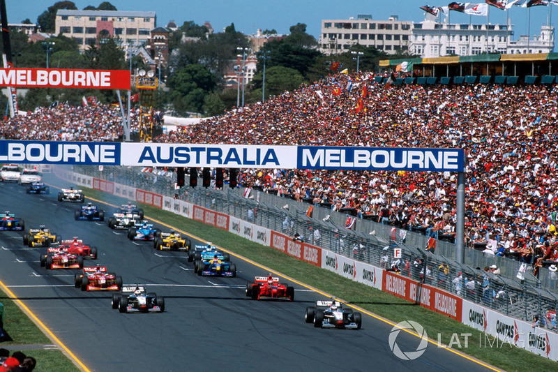 Mika Hakkinen, McLaren Mercedes MP4/13 leads the field away at the start