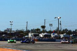 #2 Tequila Patron ESM Nissan DPi, P: Scott Sharp, Ryan Dalziel, Olivier Pla slides wide in turn 1 at