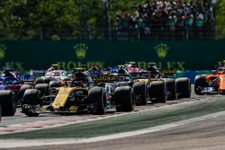 Carlos Sainz Jr., Renault Sport F1 Team R.S. 18, leads Kevin Magnussen, Haas F1 Team VF-18, Nico Hulkenberg, Renault Sport F1 Team R.S. 18, Fernando Alonso, McLaren MCL33, and the remainder of the field at the start of the race