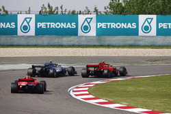 Valtteri Bottas, Mercedes AMG F1 W09, passes Kimi Raikkonen, Ferrari SF71H, for the lead of the race. Sebastian Vettel, Ferrari SF71H, follows