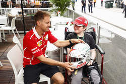 Sebastian Vettel, Ferrari, meets a young fan