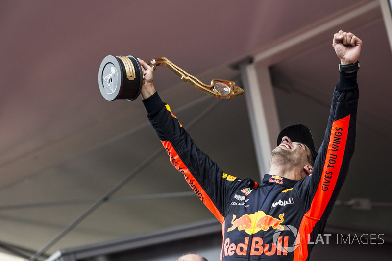 Race winner Daniel Ricciardo, Red Bull Racing celebrates on the podium with the trophy